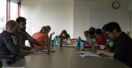 Students around a conference table